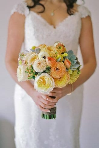 A beautiful bouquet made of round white, pink and green flowers