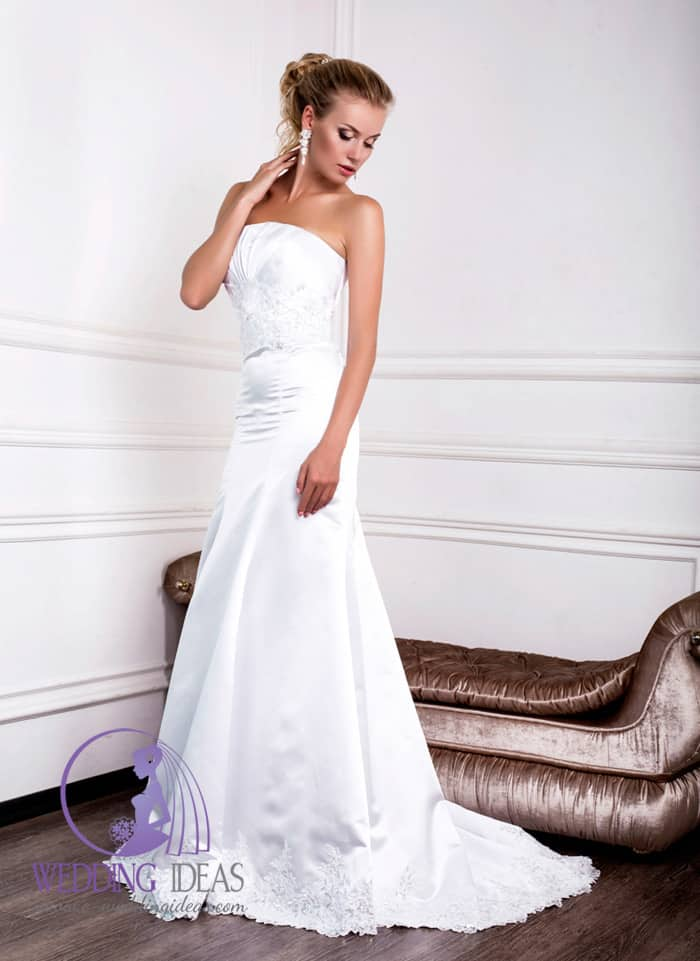 Bride dress has a-line with straight necklace, lace design on the bodice.