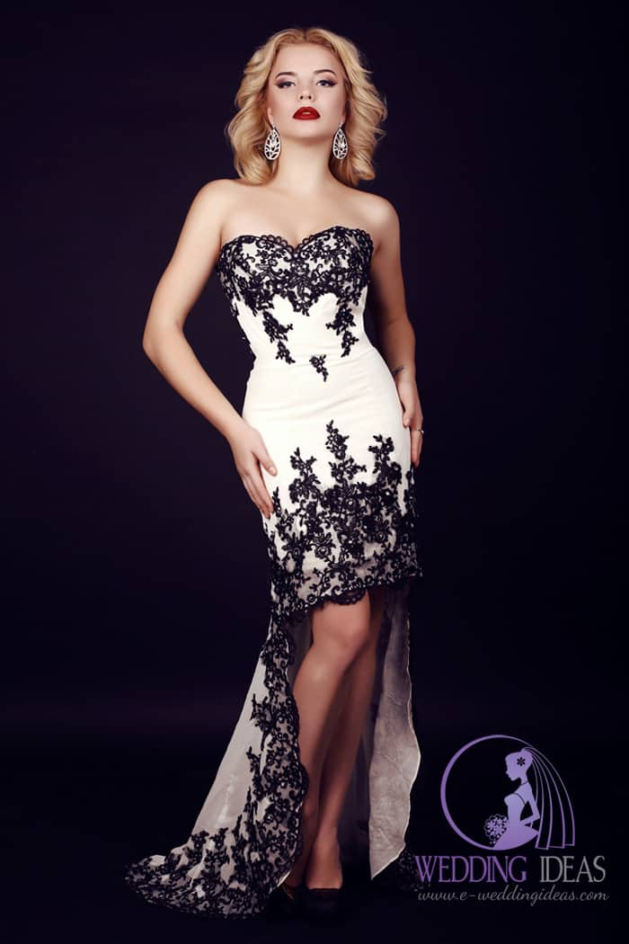 Hi-low wedding dress with black lace design and sweetheart necklace.