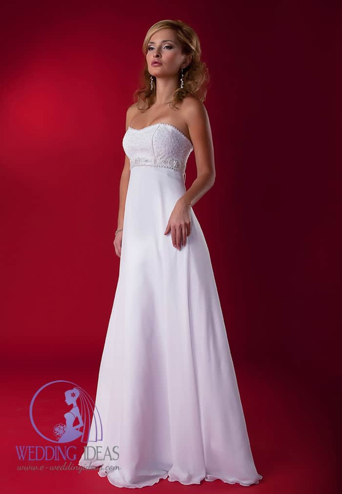 Wedding dress has delicate sweetheart necklace, shiny design on the bust and flower crystal belt under bust. Smooth long satin skirt.