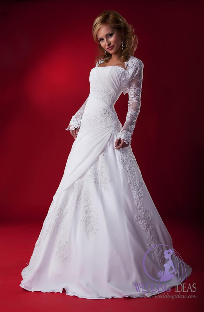 Ball gown with straight necklace and long sleeve lace bolero. Lace design on the bodice and skirt. Pleated bodice on the bust.