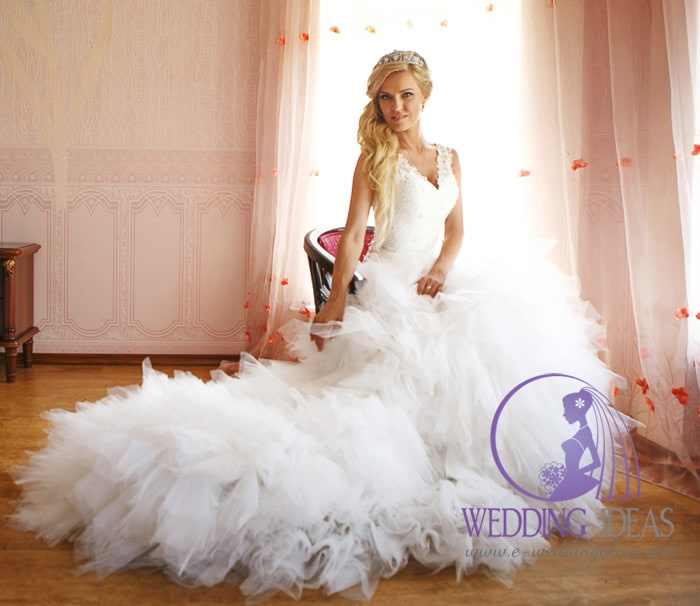 V-neck lace gown with tulle skirt with long train.