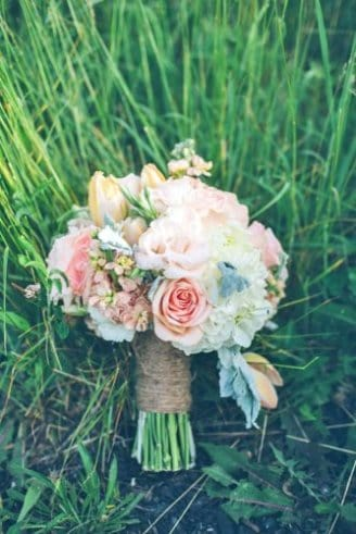 A gorgeous bouquet comprised of pink, white and blue flowers