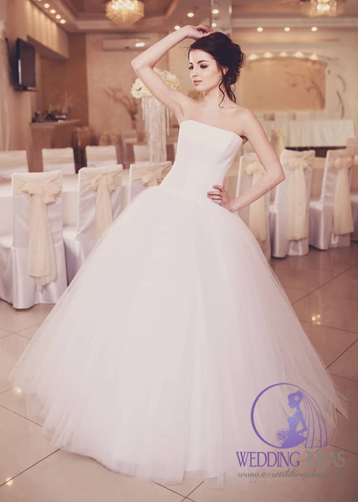 170. Ball gown with straight necklace. Smooth satin bodice and long tulle skirt. Perfect for everybody who don't like any design on the bodice. Brown pinned up hair and strong eye makeup, with matt pink lips.