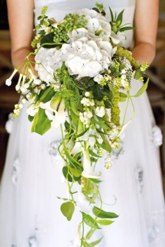 Phlox - white flowers; Mini Calla Lily - white flowers in the shape of a hanging cup; Lily of the Valley - small white hanging flowers; Snoberry - small white balls