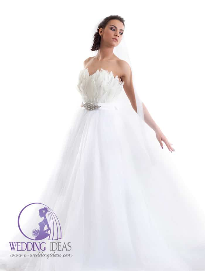 172. Ball gown with bodice from feathers. Satin belt in the waist with crystal brooch in the middle. Long tulle skirt.