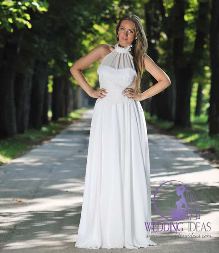 178. Lace high neck with lace design on the bodice. Long straight skirt. Long straight dark blond hair. Delicate eye makeup and matt nude lips. Forest in the background.