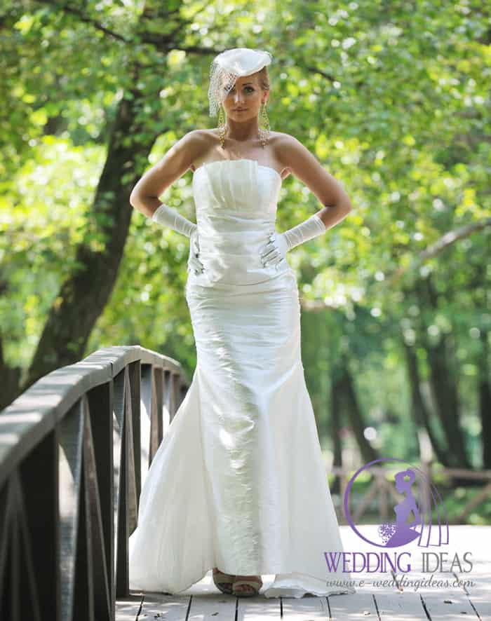 Straight necklace with flared skirt. Pleated on whole wedding dress.