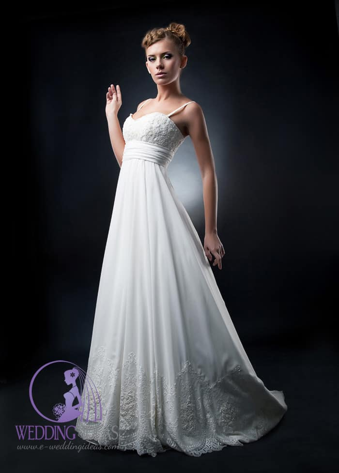 182. Scoop necklace with lace straps. Whole bride dress in lace design with delicate crystal belt in the waist. Very long veil with lace design on the end pinned in long curly brown hair.