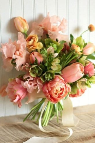 Tulips - bright pink closed flowers; Peony - large orange - red flowers; Bells of Ireland - small green flowers; Snap Dragon - bright pink frayed flowers;