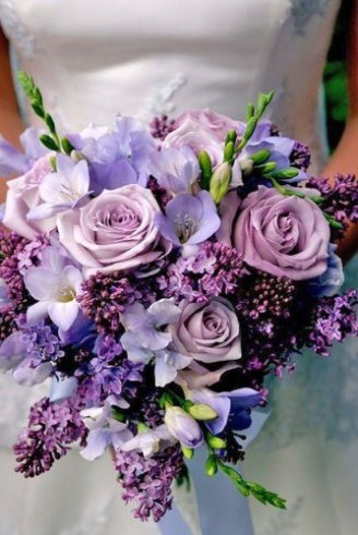 A gorgeous bouquet comprised of purple, white and green flowers