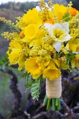 A magnificent bouquet consisting of yellow and white flowers mixed with some few small green leaves