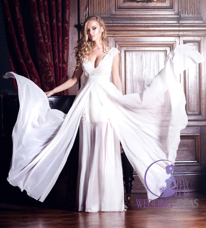 197. This bride dress has V-neck style with lace design on the bust. Satin belt and one see through layer of the dress dispelled on the wind.