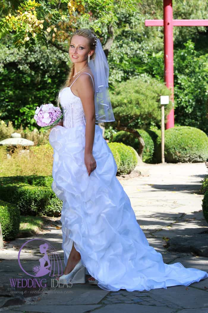 Spaghetti strap with sweetheart necklace. Bride dress see through bodice with lace design.