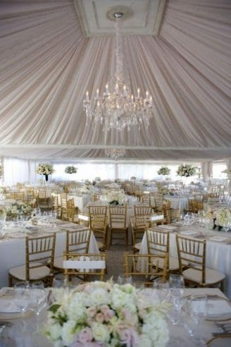 A lovely pink tent with matching seats, table clothes and flowers. It also has matching lights