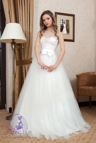 A white modest gown dress with a sweetheart-shaped bust. It barely touches the ground