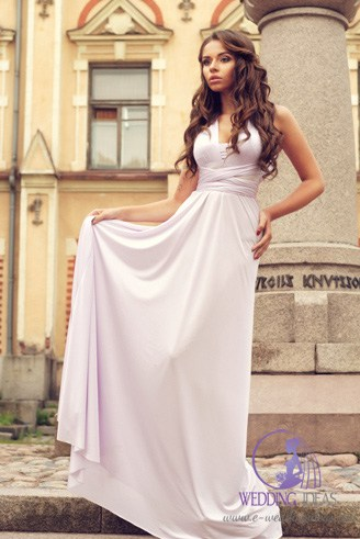 A long grey dress with a smooth texture and a V-shaped bust