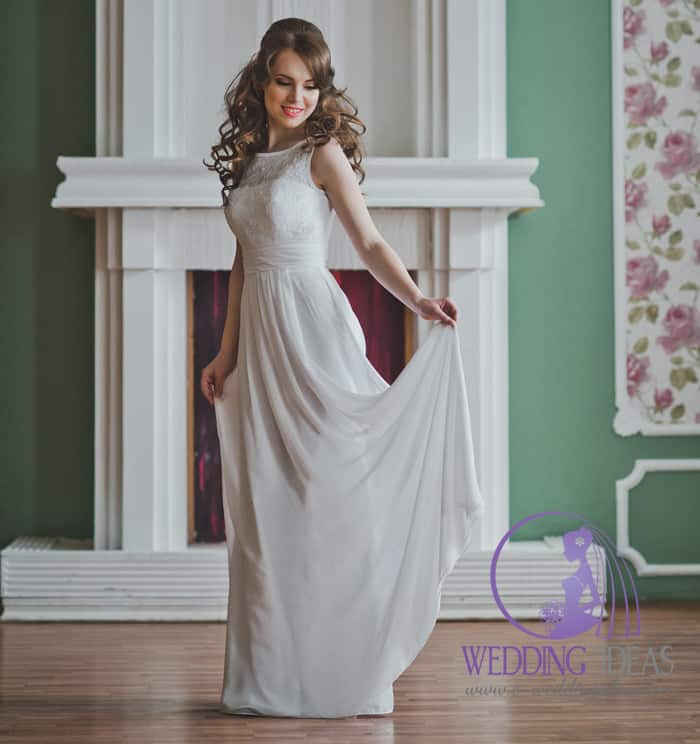 A-line gown with cowl necklace, lace design on the bodice