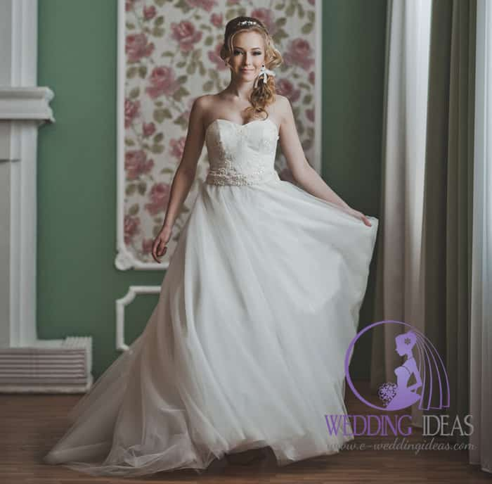 Ball gown with sweetheart necklace, lace design on the bodice