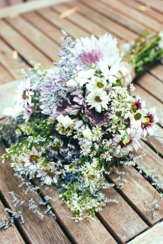 succulent blue flowers, white, yellow and pink flowers and green flower buds