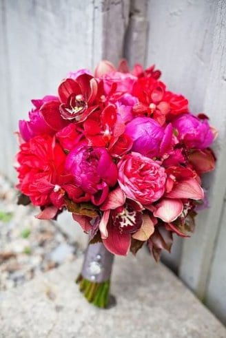 A romantic bouquet consisting of red and purple flowers