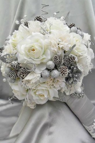 A beautiful synthetic bouquet made of large white flowers mixed with grey balls
