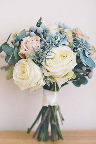 A simple but beautiful bouquet made of blue fruits, blue leaves and large white and pink flowers
