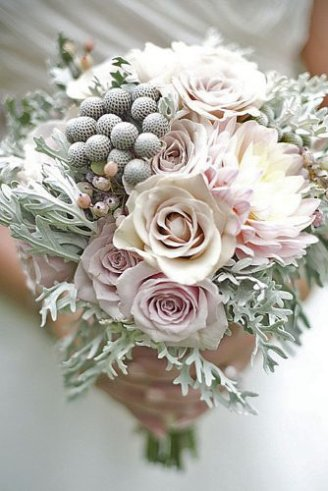 A gorgeous bouquet comprised of grey fruits, pink flowers and green leaves