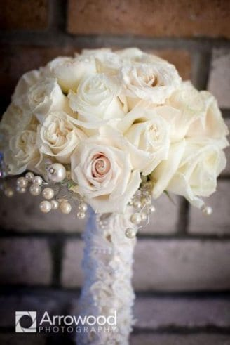 A synthetic bouquet made of white flowers and shiny balls