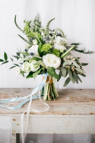 Carnation - small white flowers on the left; Decorative thistle - pricking balls in the bouquet; Lisianthus - white flowers;
