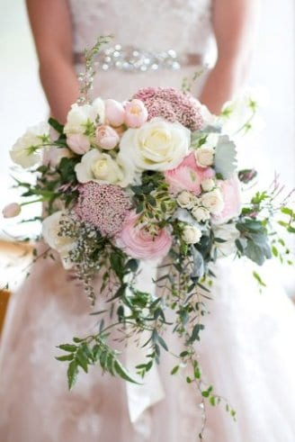 bouquet of white and pink flowers and strings of green leaves