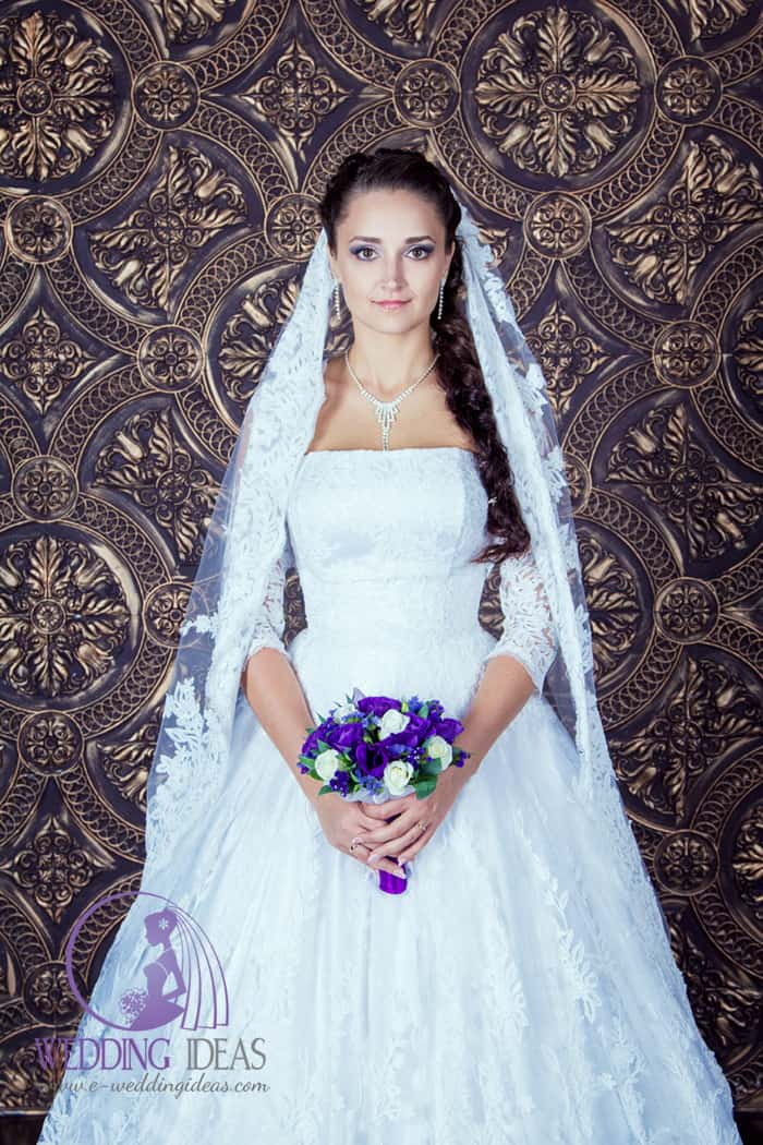 Ball lace wedding dress with a straight neckline and long lace sleeve,