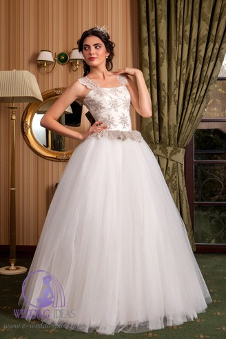 A modest white dress with flowery spaghetti straps.