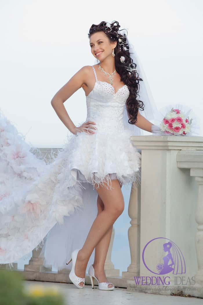 Short bride dress with spaghetti necklaces with sequins on the top and feather hem