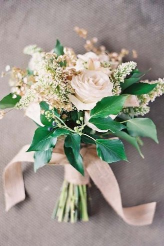 common bouquet with rose and green leaves
