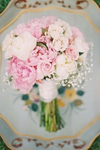 A gorgeous bouquet consisting of white and pink flowers, mixed with green leaves