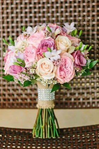 Peony - pink large flowers; Roses - light yellow - light pink flowers; Fressia - white open flowers; Wax Flower - small white flowers