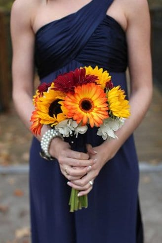 A romantic wedding bouquet made of white and red flowers mixed with sunflowers