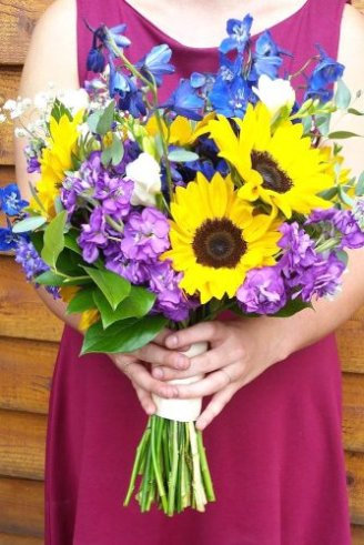 Sunflowers - large yellow flowers; Baby Breath - white flowers; Fressia - white flowers