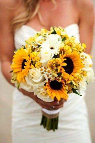 round white flowers, yellow flower buds, and sunflowers