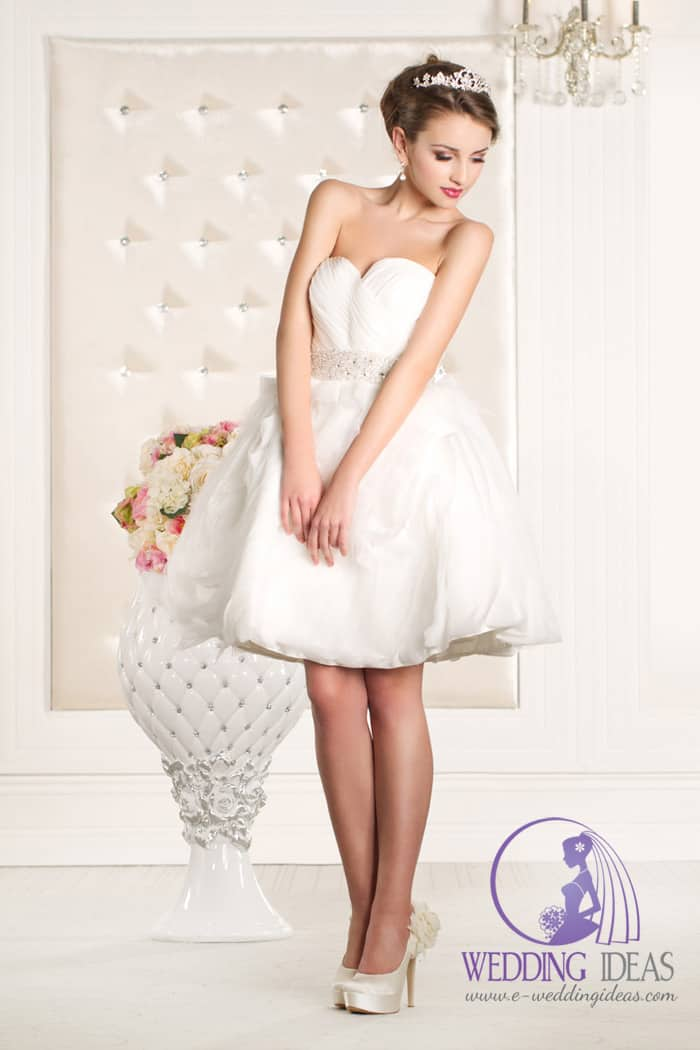 Short wedding dress with a sweetheart neckline and tulle skirt with crystal belt in the waist.