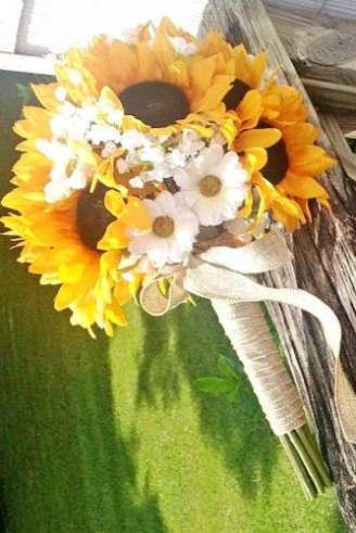 bouquet comprised of round white flowers and sunflowers