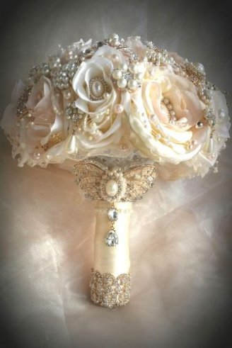 A lovely synthetic wedding bouquet made of round white flowers decorated with shiny beads