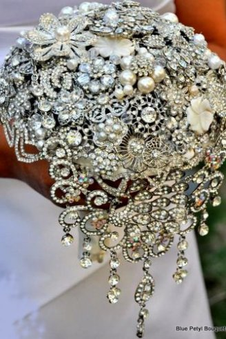 A plastic wedding bouquet made of shining beads and white flowers