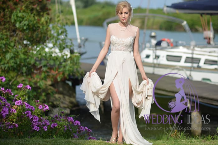 Lace illusion necklace with slits up the leg skirt. Delicate pearl jewelry. Beautiful open-air, Bride looks like go out from the boat.