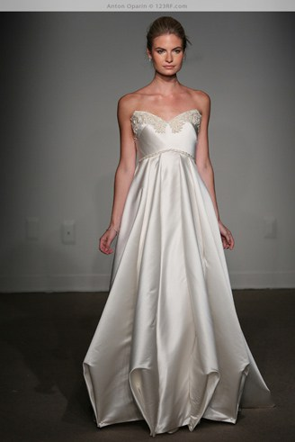 A grey bridal dress with a sweetheart-shaped bust and sequins. It has a super smooth texture.