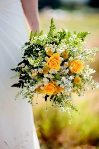 A bouquet made of white, orange and green flowers