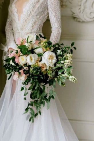 A nice wedding bouquet comprised of green, pink and white flowers