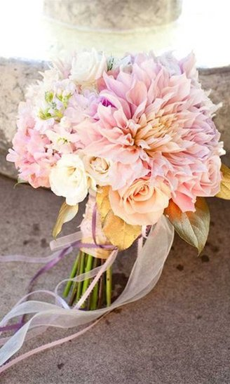 A wedding bouquet made of white and pink flowers only