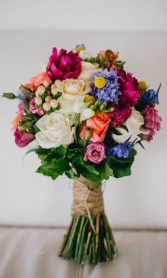 Roses - white, cream and orange flowers Lisianthus - bright pink flowers Peony - large cherry flowers Snow Berries - white pink balls Craspedia - yellow balls Hyacinth